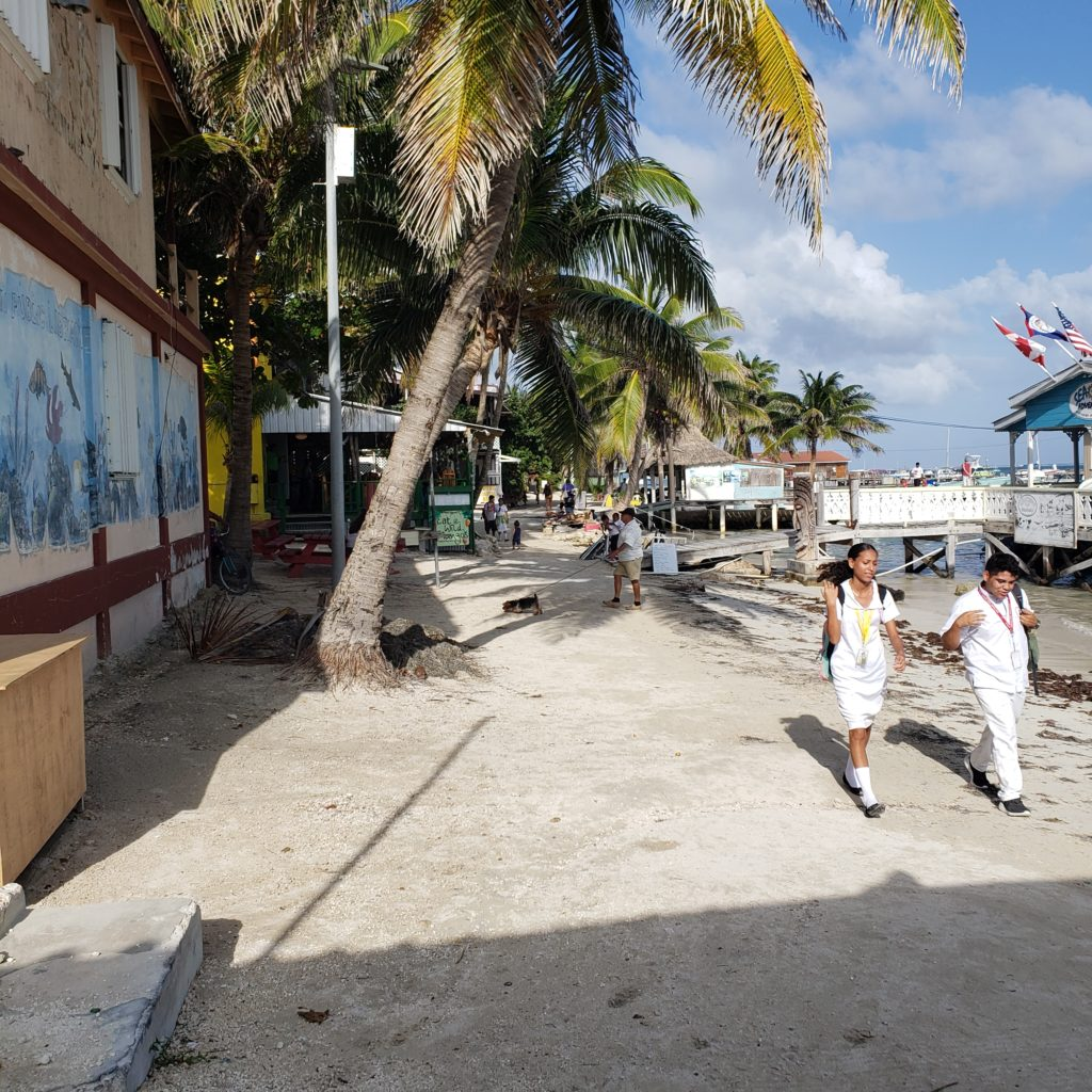 Teens in white school uniforms on the beach - San Pedro Belize