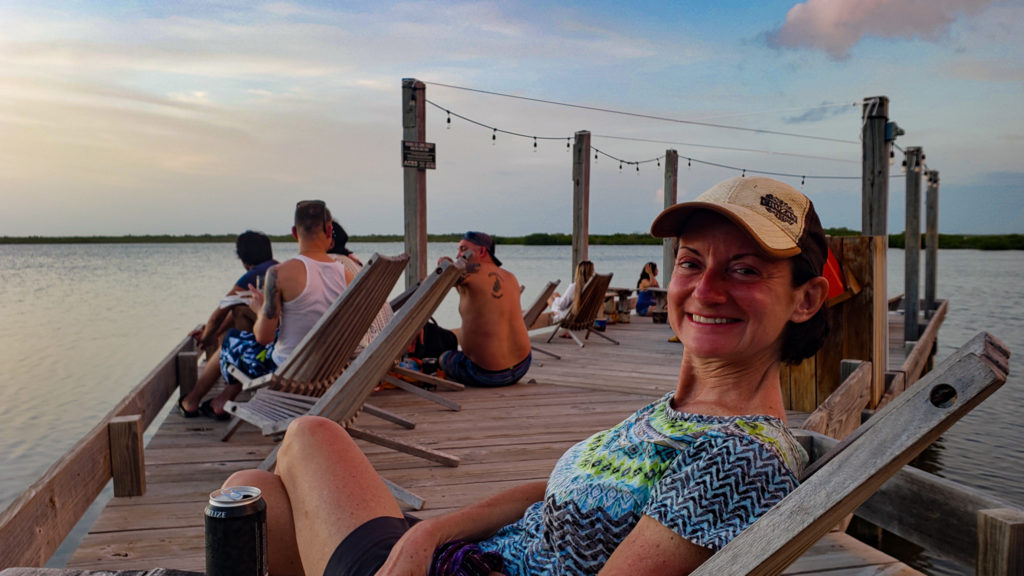 Middle aged woman waiting for the sunset Ambergris caye